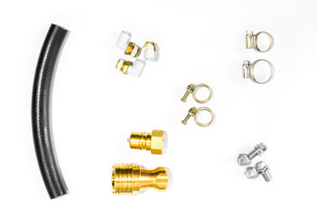 Top view of metal equipment for small pipes placed on white floor.