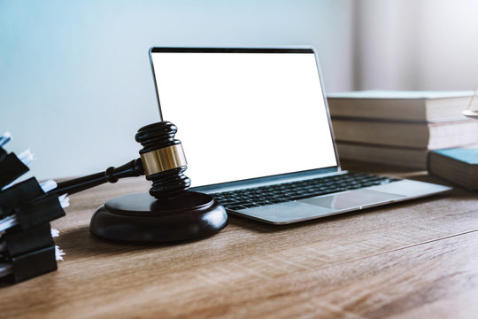 Workspace of lawyer with laptop blank white screen and law wooden gavel,legal book and brass scale of judge. lawyer and law ,judiciary and legislature courtroom legal concept. top view flatlay lawyer.