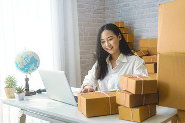 Business woman start up small business entrepreneur SME success .freelance woman working at home with Online Parcel delivery. SME and packaging  deliveryconcept