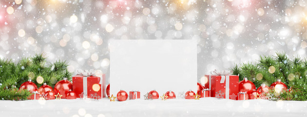Blank Christmas card laying on red baubles and gift 3D rendering