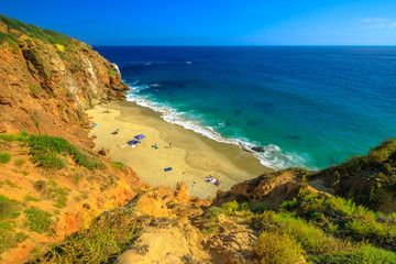 Aerial view of Pirates Cove, a hidden sandy beach in a small cove on west side of Point Dume, Malibu coast in CA, United States. California West Coast. Blue sky, summer season, sunny day. Copy space.