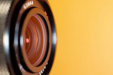 Photo lens on orange background