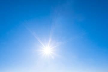 sparkle sun on a blue sky, natural background