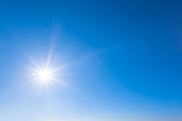 sparkle sun on a blue sky, natural background