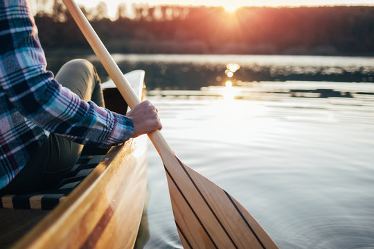 Close up of hipster girl holding canoe paddle