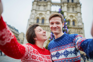 Couple taking selfie in Paris on a Christmas day