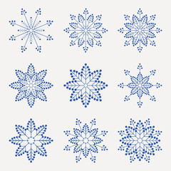 Christmas set of graceful, fragile snowflakes of blue color,