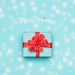 Christmas background. Pastel blue festive winter holidays backdrop. Beautifully wrapped christmas present. Xmas card.
