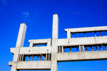 Unfinished concrete building in the blue sky