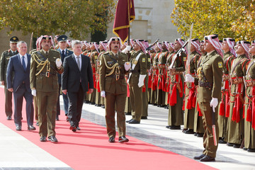 Jordan's King Abdullah and Macedonia's President Ivanov review Bedouin honour guards at the Royal Palace in Amman