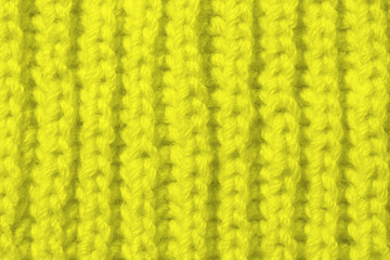 The texture of the knitted sample color Golden Lime . Fashionable palette of this season.