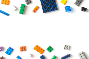 Plastic building blocks isolated on white background. Free space for inscriptions.