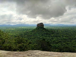 A single mountain in the middle of the Sri Lanka jungle