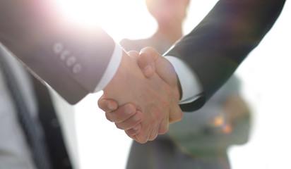 background image of handshake of business people .