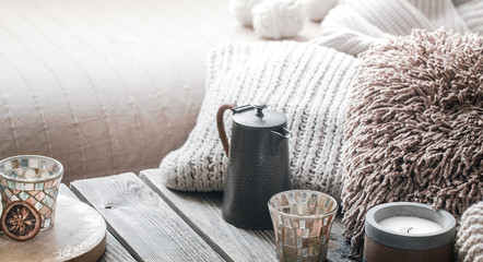 still life from home interior on a wooden background with a candle