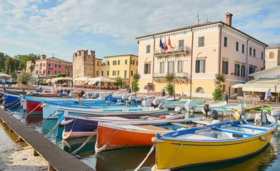"Harbor of city of ""Bardolino"" with colorful boats at Lake Garda in Italy"