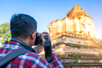 Asia travel, Traveler shooting a old temple photo at Chiang Mai, Thailand.