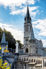 view of the basilica of Lourdes in autumn, France