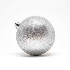 Single glittering silver Christmas tree decorative ball isolated on a white background