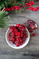 Cooked fresh red cranberries on white dish
