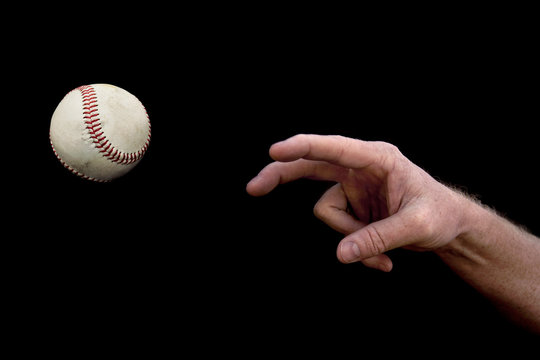 Arm throwing a Baseball