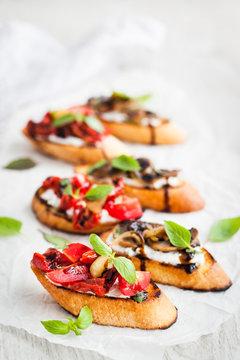 Sun dried tomatoes, cream cheese and fried mushrooms bruschetta