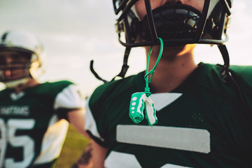 Young American football player with his mouthguard out during pr