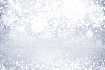 Abstract silver glitter bokeh lights with soft light background.