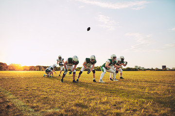 American football team practicing place kicking on a sports fiel