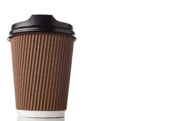 Blank kraft paper coffee cup with cap. Disposable cup with copy space