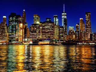 Manhattan new york city skyline at dusk from brooklyn side