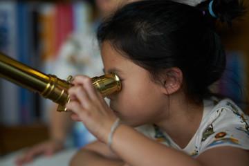 Girl use telescope alone