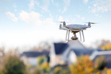 drone flying front of home Wall mural