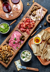 Antipasto Platter. Ham serrano, salami olive jamon dip sauces and red wine