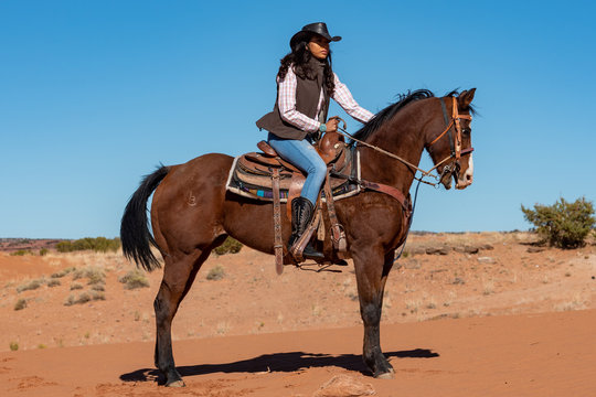 young native american woman riding horse