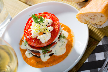 Grilled eggplant and tomatoes stack with spicy sauce