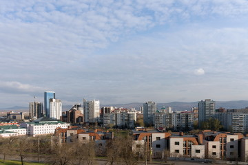 View of the central district of the city of Krasnoyarsk from the hill in the spring afternoon. Krasnoyarsk Region. Russia.