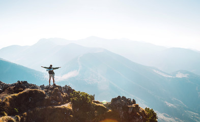 Mountain hiker with backpack tiny figurine stands on mountain peak Wall mural