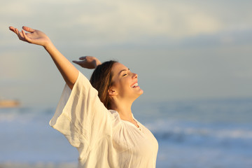 Joyful woman enjoying a day on the beach
