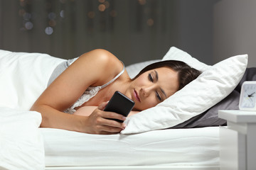 Serious woman checking smart phone content in the night