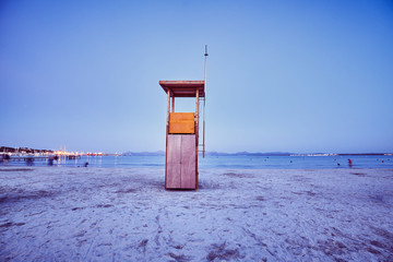 Retro toned picture of a lifeguard tower at dusk, Mallorca, Spain.