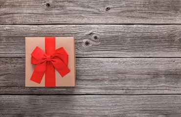 Stylish gift box on the background of wooden boards.