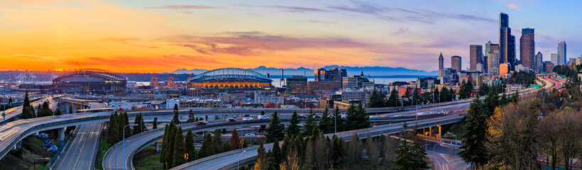 Seattle downtown skyline panorama at sunset from Dr. Jose Rizal or 12th Avenue South Bridge with traffic trail lights Wall mural