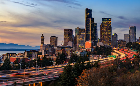 Seattle downtown skyline sunset from Dr. Jose Rizal or 12th Avenue South Bridge with traffic trail lights