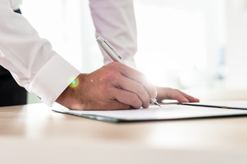 Businessman signing contract or application form