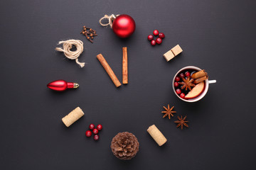 A clock in the form of spice for mulled wine. Cinnamon, anise stars, cranberries, brown sugar. Concept, creative work.