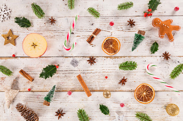 Christmas decorations on old wooden background. Top-down view.