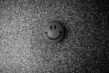 Emoji round plastic joyful smiling smiling toy round face on a black and white background