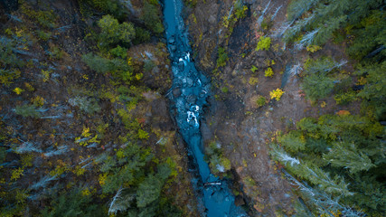 Aerial view looking down at a river running through the rugged mountain forests of western Washington state USA
