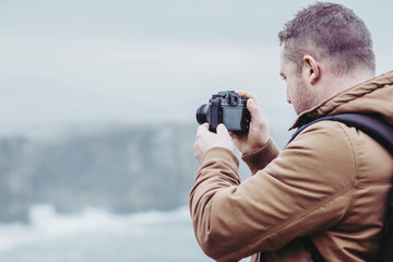 man in the cliff photographer